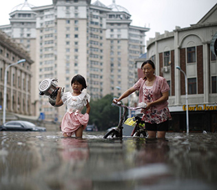 At least 75 dead, missing in recent China flooding