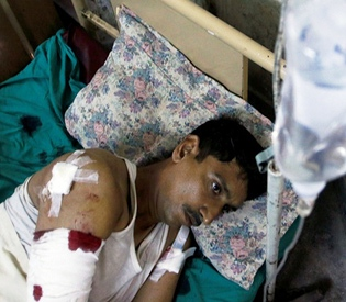 Bombs kill at least 12, wound dozens at Pakistan court