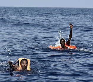 At least 28 dead on migrant boat off Libya