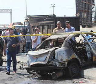 Suicide bomber kills at least 10 in town north of Baghdad