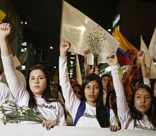 Thousands of Colombians march to save peace deal with rebels