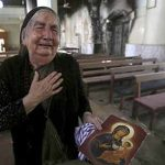 Gasps, tears as Iraqis return to Islamic State-destroyed parish