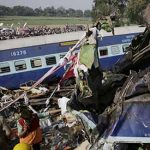 Train derails in north India, killing 96 and trapping others