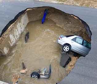 car plunges sinkhole