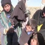 Iraqi women burn face veils in joy after their village liberated from ISIS