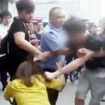 Man beats up girlfriend in broad daylight in front of their young son
