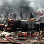 Car bombing at busy Baghdad market kills 12 people