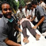 Stampede on crowded Indian pedestrian bridge leaves 22 dead