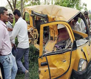 Train hits school van at India crossing, killing 13 children