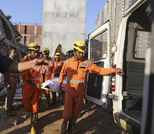 Rescuers find 9 bodies after two buildings collapse in India
