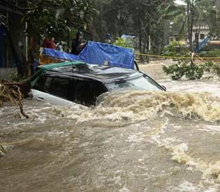 Monsoon rain flooding, landslides kill 26 in southern India